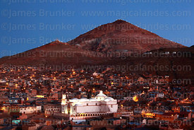 View of Cerro Rico and San Benito church at sunset, Potosí, Bolivia