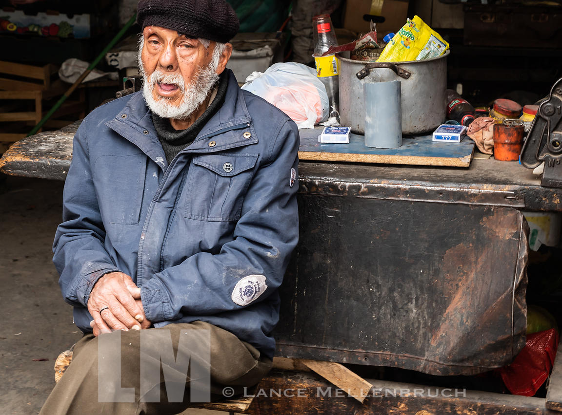 Sitting old Peruvian man on the streets of Arequipa, Peru