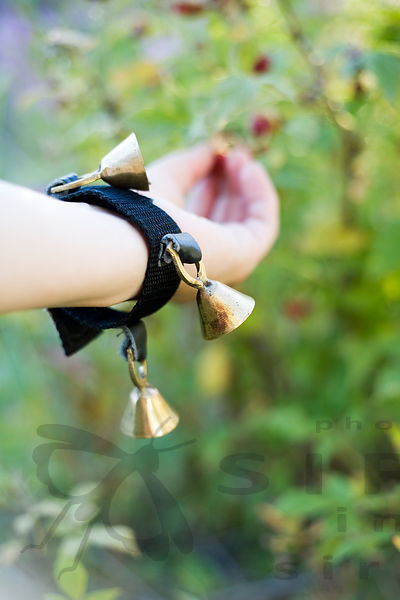 A bell warns bears that the berry picker is close by