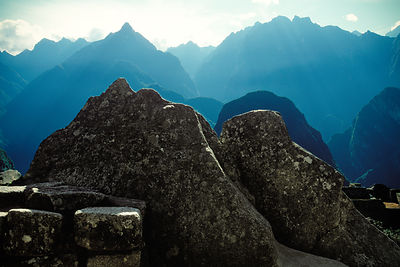"Inca artists mirrored the abstract forms of the surrounding peaks by carving large granite ""image stones.""  Macchu Picchu, Peru"