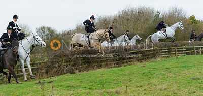 Competitors in the Dianas of the Chase Cup jump the first hedge of the race
