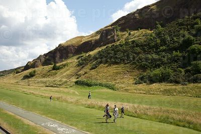 Visitors Walking close to Arthurs Seat in Holyrood Park