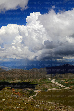 View looking down Calderillas Valley towards thunderstorm in distance over Concepcion Valley, Cordillera de Sama Biological R...