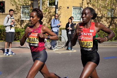 Tirunesh Dibaba (3rd) of Ethiopia and Edna Kiplagat (1st) of Kenya Running in the  Elite Womens Event at the 2014 Virgin Lond...