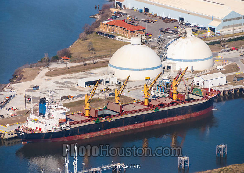 Cement loading of dry bulk cargo ship and dome-shaped storage silos
