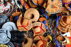 Keyrings with miniature regional leather hats for sale in souvenir shop, Tarija, Bolivia