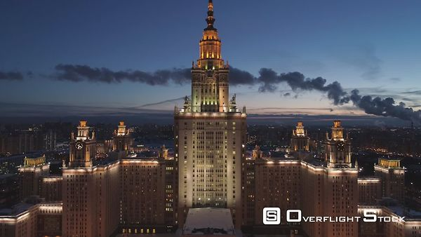 Moscow State University Main Campus and Illuminated Moscow Cityscape at Winter Twilight. Russia. Aerial View. Drone is Flying...