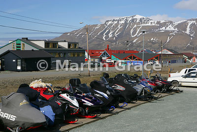 Snowmobiles parked up for the summer, awaiting winter snows, Longyearbyen, Svalbard