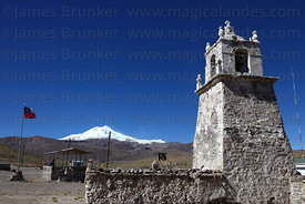 Guallatiri village square, church and bell tower , Guallatiri volcano in background , Las Vicuñas National Reserve , Region X...