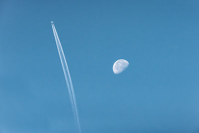 Airliner passing morning Moon