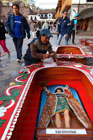 Worker putting finishing touches to San Cristol for Corpus Christi festival decorations, Cusco , Peru