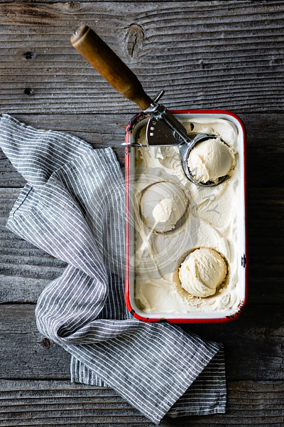 Homemade maple sugar ice cream on a wooden background