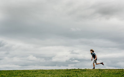 Danish boy running in a field 3