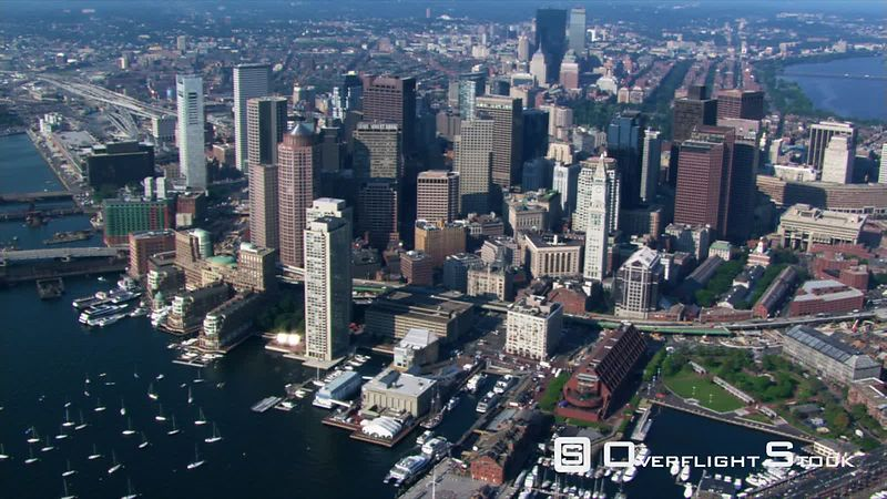 Flight over Boston Harbor with cityscape view.