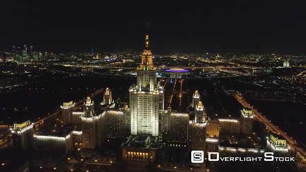 Moscow State University Main Campus and Illuminated Moscow Skyline at Clear Winter Night. Russia. Aerial View. Drone is Flyin...