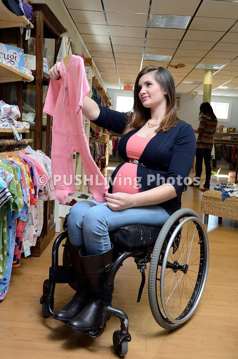 41223392e56db PUSHLiving Disability Stock Images Pregnant Mom in wheelchair ...