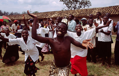 Rwanda - Kibileze - Traditional Rwandan dancers perform and villagers dance for a spectacle warning of the dangers of HIV and...