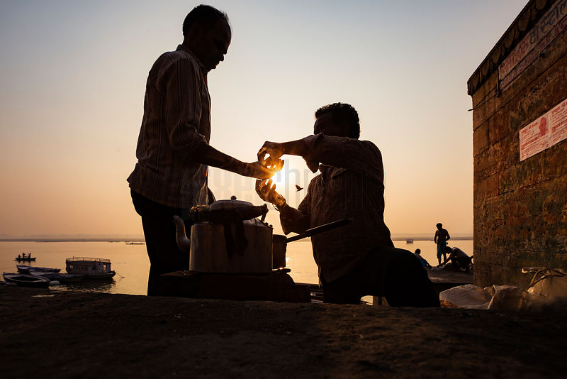 Chai Wallah Giving Change for Tea at one of the Ganges River Ghats