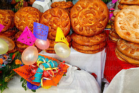 Loaves of bread and decorated basket for sale during Comadres festival, Tarija, Bolivia