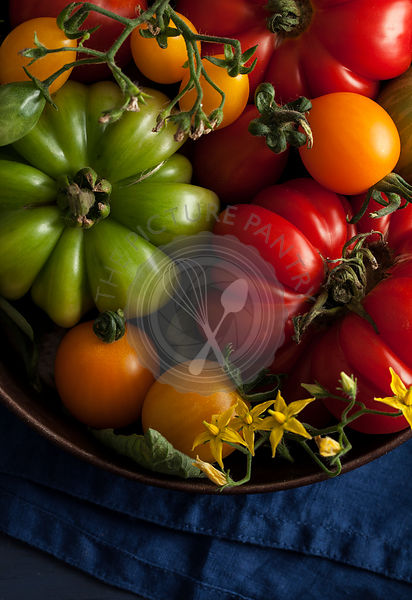 Fresh summer tomatoes in metal bowl