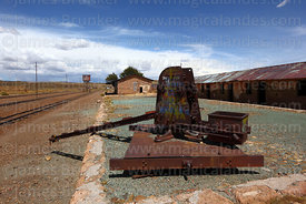 Rusting crane on platform in disused railway station in General Pando, La Paz Department, Bolivia