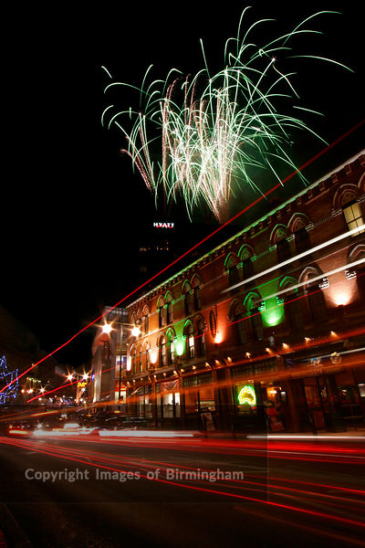 Fireworks over Broad Street, Birmingham at night.  The entertainment district of the city. England, UK.