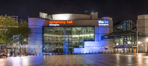 A night view of Birmingham city centre at night, showing Centenary Square and the ICC and Symphony Hall.