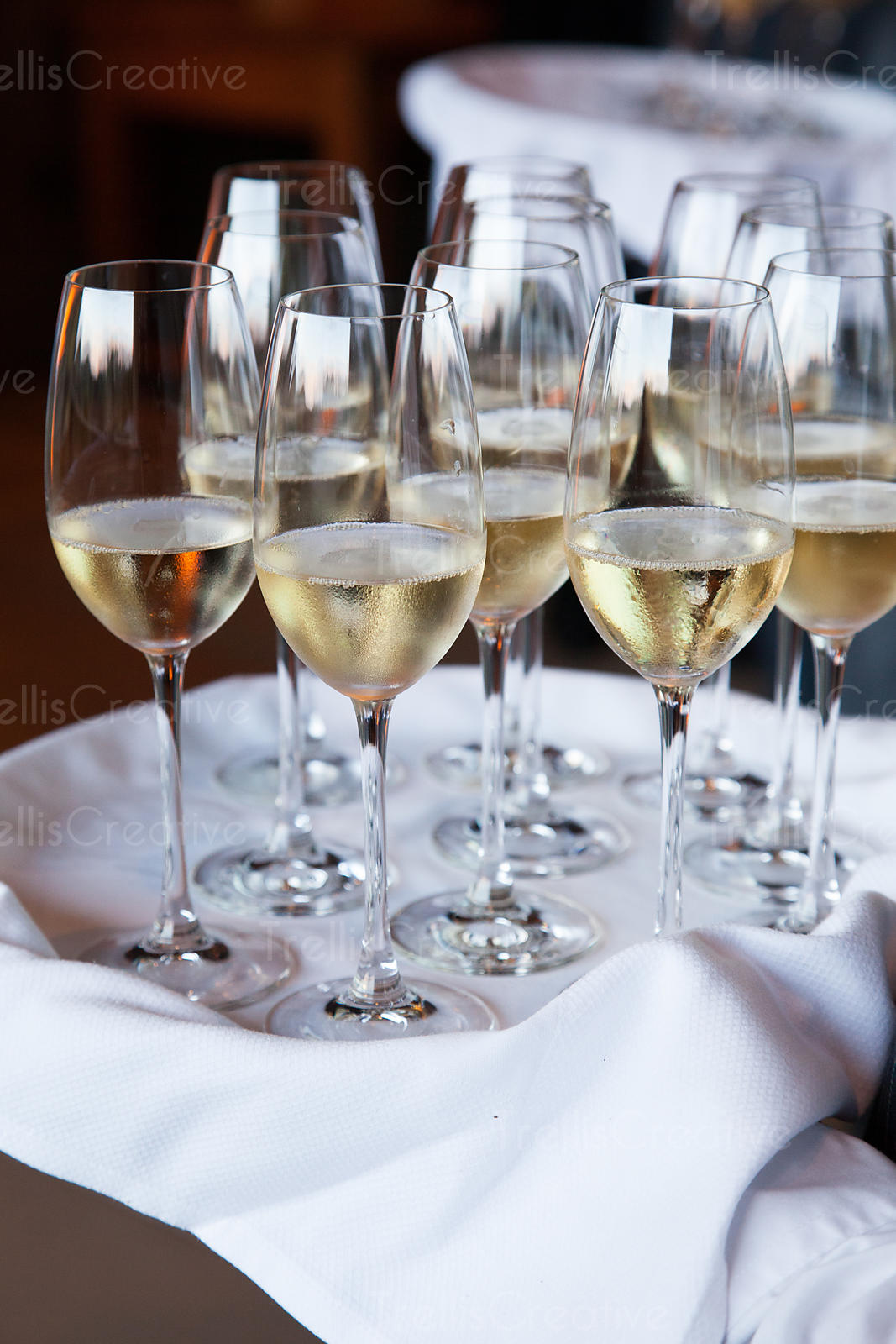 A tray of crystal flutes filled with french champagne