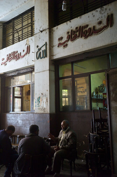 Egypt - Cairo - Men sit and talk outside the El Nadawa El Thaqafiya cafe
