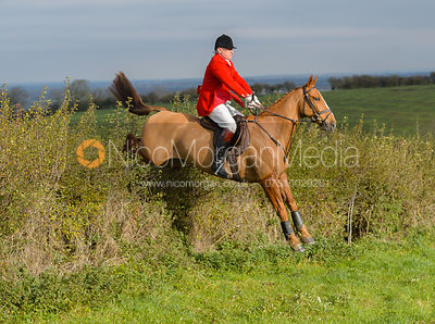 Michael Dungworth jumping a hedge near Clawson Thorns