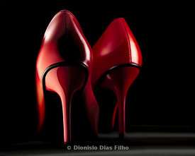 Red high heel shoe seen by brings