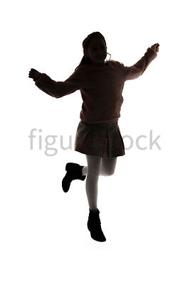 A Figurestock image of a girl in silhouette, jumping and skipping – shot from mid level.