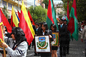College girl holding badge of Bolivia's former Litoral Department during parades for Dia del Mar / Day of the Sea , La Paz , ...