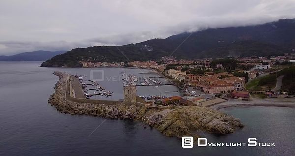 Aerial, a little port of Marciana Marina on Elba island in Tuscany, Italy on a cloudy day