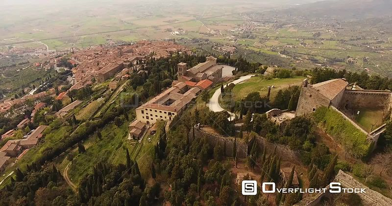 Aerial shot, basilica di Santa Margherita and Medici fortress of Girifalco at Cortona in Tuscany, Italy, 4K