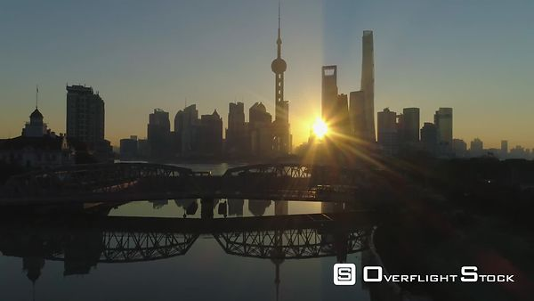Panoramic Shanghai Skyline at Sunrise. Lujiazui Financial District and Huangpu River. China. Aerial View. Drone is Flying Upw...