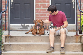 rottweiler and man sitting on front step