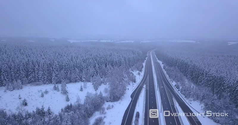 Highway A27 E42 Cutting Through Forested Area in Winter North of Malmedy Belgium