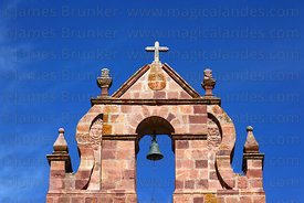 Detail of stone carvings on left bell gable of colonial church at Laja , Bolivia