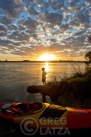 Boy and Kayaks at Lake