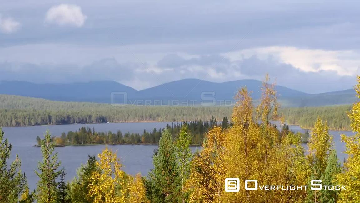 Autumn Color Landscape, Zoom Out Time Lapse of Autumn Trees, a Lake and Fjeld Tunturi Mountains, on a Sunny and Rainy Fall Da...