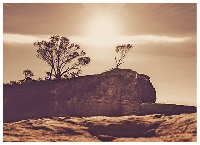 Sunrays backlight Hanging Rock in Blackheath, Blue Mountains Australia.   Toned momochrome. NSW Australia