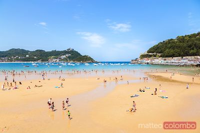 Playa de la Concha crowded with tourists, San Sebastian, Spain