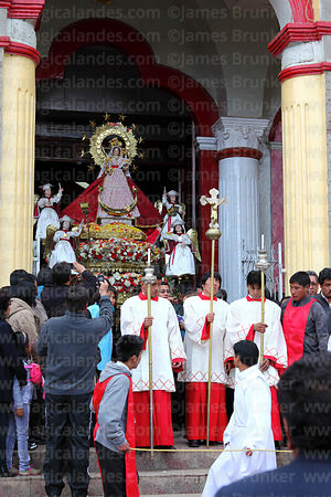 Statue of Virgen de la Candelaria being carried out of her Sanctuary to watch dance parades, Puno, Peru