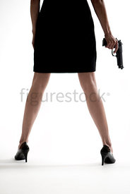Looking through a woman's legs, standing with a gun – shot from low level.