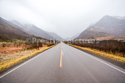 Empty highway through a mountainous area in the Lofoten Islands