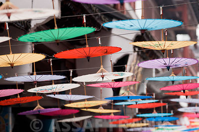 Asia, Shanghai, Close-up of colorful umbrellas hanging in market