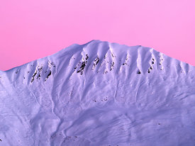 Snow covered summit at sunrise