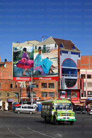Traffic and adverts for Cholita Collection fashion campaign on wall of building, El Alto, Bolivia