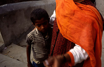 India - Delhi - A social worker comforts a street boy who has been bullied
